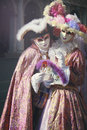 Noble couple in elegant silk dress with veil venice carnival Stock Image