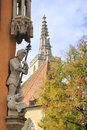 Noble crusader with spear above the fallen dragon statues in rothenburg on tauber germany Stock Image