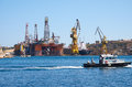 The noble paul romano oil rig in the palumbo shipyards malta cospicua july view of with pilot boat passing by cospicua x Royalty Free Stock Photos