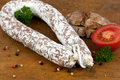 Noble salami with bread on a wooden board Royalty Free Stock Image