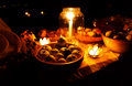 Nocturnal feast held in nature with enchanting lotus shape cande holders. Royalty Free Stock Photo