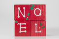 Noel blocks painted red green and white spell out for a christmas decoration Royalty Free Stock Image