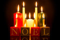 Noel candles black background against a Royalty Free Stock Images