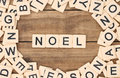 Noel christmas spelled out in tan tile letters Royalty Free Stock Photography