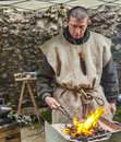 Nogent le rotrou france may environmental portrait medieval blacksmith working fire reenactment historical festival nogent le Royalty Free Stock Image