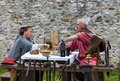 Nogent le rotrou france may medieval mature couple having their lunch outdoor near tent historical reenactment festival nogent le Stock Image