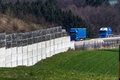 Noise barrier a on the a motorway in austria protects the residents against the of cars and trucks Stock Photos