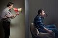 Noisy neighbors man at night yells through a megaphone at the neighbor Royalty Free Stock Photo