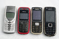 Nokia old mobile phones previous models of in white background Stock Images