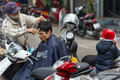 Nomad hairdresser hanoi vietnam december a is working outside in the city his customer is sitting on his motorbike in hanoi Stock Images
