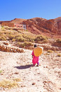 Nomad woman in the desert returning home Stock Photos