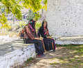 Nomad women bhutan two woman are sitting outside the dzong of punakha trying to sell hats they are wearing the typical costume Royalty Free Stock Image