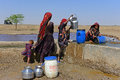 Nomads tribes nomadic s collecting water from a reservoir at the runn of kutch gujarat Royalty Free Stock Photography