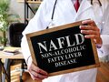 Non-alcoholic fatty liver disease NAFLD the doctor is holding a sign. Royalty Free Stock Photo