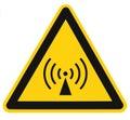 Non-ionizing radiation hazard safety area, danger warning sign sticker label, large icon signage, isolated black triangle yellow Royalty Free Stock Photo
