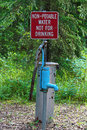 A non-potable water, not for drinking sign near a pump Royalty Free Stock Photo
