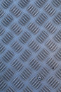 Non-slip industrial steel metal flooring, shot from above, flat lighting. Royalty Free Stock Photo