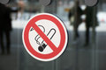 Non-smoking sign on a glass wall as a sign of prohibition Royalty Free Stock Photo