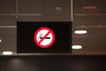 Non smoking sign hanging from the ceiling a black illluminated with a red not permitted or don t smoke iconic message hangs a in a Stock Photos