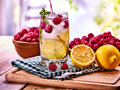 Nonalcoholic cocktails with lemon slice and raspberries with mint leaf. Royalty Free Stock Photo