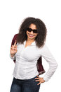 Nonchalant woman with sunglasses cut out image of a young brown curly hair afro and who is holding a jacket over her shoulder Royalty Free Stock Photography
