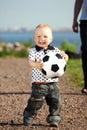 男孩作用足球 免版税库存照片
