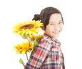 愉快的小女孩用向日葵 免版税图库摄影