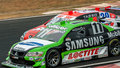 Nono and tarso racing stock cars green black car competing with red white car in high speed at interlagos grand prix circuit Royalty Free Stock Photography