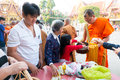 Nonthaburi thailand jan unidentified buddhist monks are given food offering from people in the morning for new year day on january Stock Photos