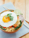 Noodle and fried egg in bowl asia culture food Royalty Free Stock Photo