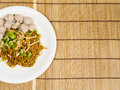Noodle and meatballs on bamboo Royalty Free Stock Photography