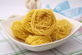 Noodle nests in a bowl Royalty Free Stock Image