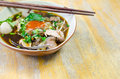 Noodle soup thai with meat on wooden table Stock Image