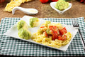Noodles with broccoli bacon and tomato on complex background Stock Photography