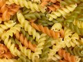 Noodles full frame background with lots of milticolored fusilli Royalty Free Stock Image