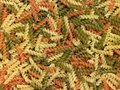 Noodles full frame background with lots of multicolored fusilli Stock Photo