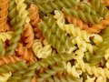 Noodles full frame background with lots of multicolored fusilli Stock Images