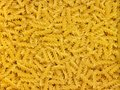 Noodles full frame background with lots of yellow Stock Photos