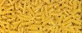 Noodles full frame background with lots of yellow fusilli Stock Photography