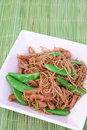 Noodles and green beans Stock Photos