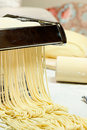 Noodles and pasta machine. Royalty Free Stock Photos