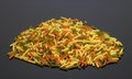 Noodles pile of of multicolored fusilli in dark reflective back Royalty Free Stock Photography