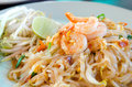Noodles with shrimp stir fried egg lemon and fresh vegetable Stock Images