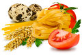 Noodles and vegetables egg pasta tomato slice tomatoes ears of wheat fresh parsley leaf quail egg on a white background Royalty Free Stock Photo