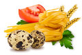 Noodles and vegetables egg pasta tomato slice tomatoes ears of wheat fresh parsley leaf quail egg on a white background Royalty Free Stock Photos