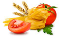 Noodles and vegetables egg pasta tomato slice tomatoes ears of wheat fresh parsley leaf on a white background Stock Photos