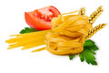 Noodles and vegetables egg pasta tomato slice tomatoes ears of wheat fresh parsley leaf on a white background Stock Images