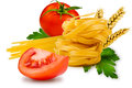 Noodles and vegetables egg pasta tomato slice tomatoes ears of wheat fresh parsley leaf on a white background Royalty Free Stock Image