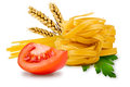 Noodles and vegetables egg pasta tomato slice tomatoes ears of wheat fresh parsley leaf on a white background Royalty Free Stock Photo