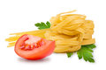 Noodles and vegetables egg pasta tomato slice tomatoes fresh parsley leaf on a white background Royalty Free Stock Images